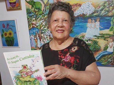 """Artista plástica Maria Antônia lançou """"Aruaçu, o Sapo Cantador"""" - São João das Rainhas hoje no Clube da AEC"""